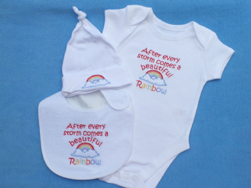 After a storm comes a beautiful rainbow embroidered baby bib, bodysuit and hat